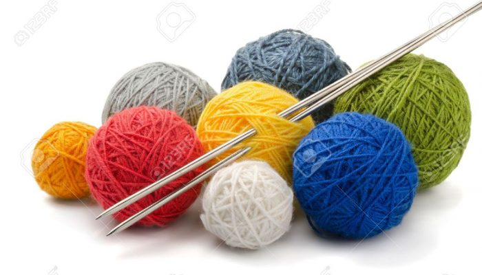 13026643-color-yarn-balls-and-knitting-needles-isolated-on-white